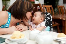 Free Mother And Child At The Dining Table Royalty Free Stock Photography - 19927827