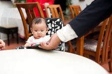 Free 7 Month Old Asian Baby Girl, Holding The Menu Royalty Free Stock Images - 19927899