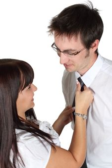 Lady Helping Man With Necktie Stock Photography