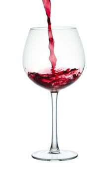 Stream Of Red Wine Falling In Glass Royalty Free Stock Photography