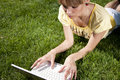Free Young Woman With Laptop Sitting On Green Grass Stock Photo - 19935610