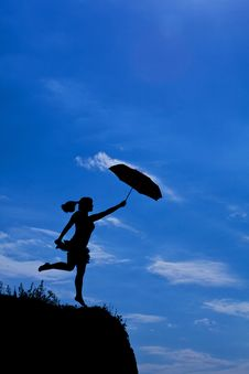 Free Silhouette Of Girl Flight With Umbrella Royalty Free Stock Photos - 19931948