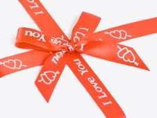 Free Red Gift Bow With Hearts. Royalty Free Stock Photos - 19936288