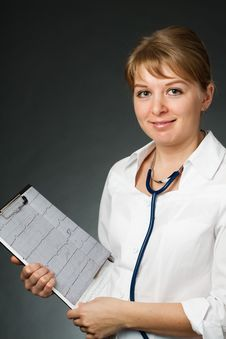 Free Doctor With Stethoscope And Electrocardiogram Royalty Free Stock Photography - 19937527