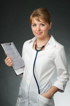 Free Doctor With Stethoscope And Electrocardiogram Stock Image - 19937531