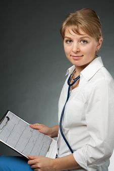 Free Doctor With Stethoscope And Electrocardiogram Royalty Free Stock Photos - 19937548