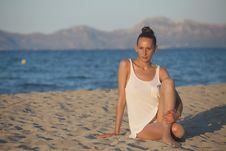 Free Woman Sitting At The Beach By Sunset Stock Photos - 19949763