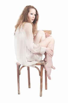 Free Portrait Of Beautiful Woman Sitting On Chair Stock Images - 19956024
