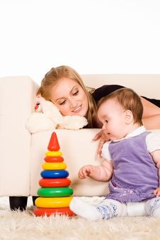 Free Little Kid Plays With Mom Royalty Free Stock Photo - 19956415