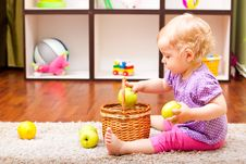 Free Little Girl Playing With Apple And Lemons Stock Image - 19957011