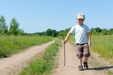 The Little Boy Walks On Rural Road Royalty Free Stock Photo