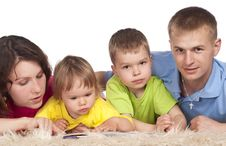 Free Family On Carpet Stock Photo - 19957730