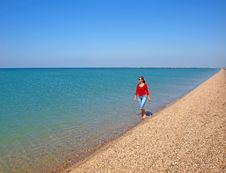 Young Woman Walking On A Coastline Royalty Free Stock Photography