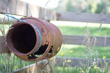 Free Rusty Antique Milk Can Tied To Fence Stock Images - 19958744