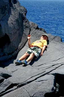 Free Happy Boy Lies On The Rock Royalty Free Stock Photo - 19958795