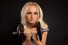 Strong Young Girl Working Out With Dumbbells. Stock Images