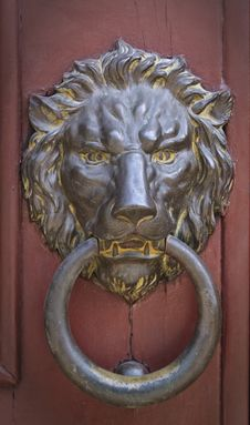 Brass Doorknocker In The Shape Of Ferocious Lion Stock Photography
