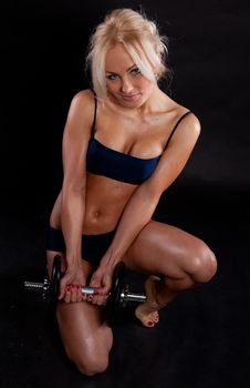 Strong Young Girl Working Out With Dumbbells. Stock Image