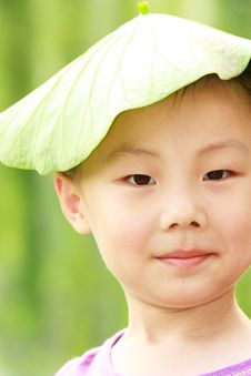 Free Asian Boy With Leaf Cap Stock Image - 19959601
