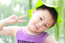 Free Asian Boy With Leaf Cap Royalty Free Stock Photos - 19959638