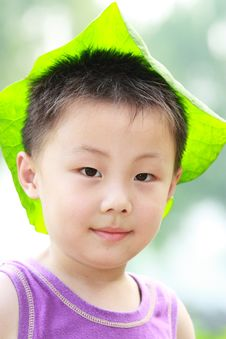 Free Asian Boy With Leaf Cap Royalty Free Stock Photos - 19959668