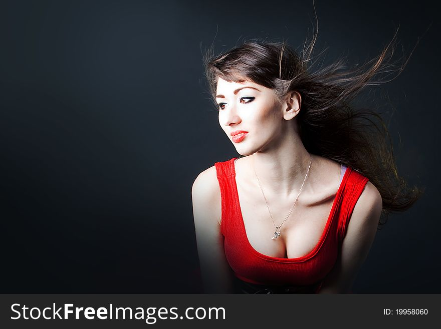 Young sexy woman in a red dress