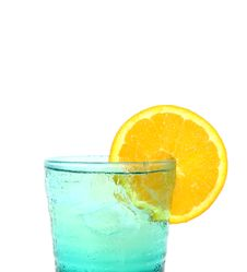 Free A Blue Glass Of Orange Royalty Free Stock Photo - 19962645