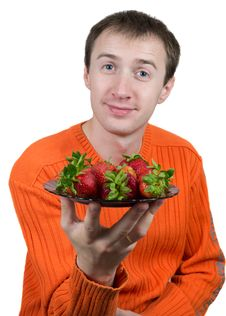 Young Man Holding A Strawberry Royalty Free Stock Photo