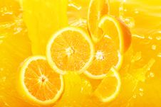 Fresh Oranges Falling In Juice Stock Photography