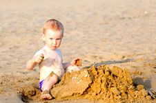 Free Adorable Kid Building Sandcasle Stock Image - 19969721