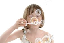 Freckled Child Playing With Bubble Royalty Free Stock Photography