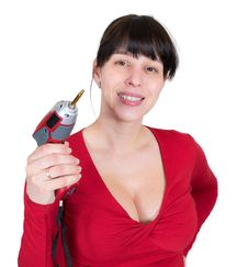 The Young Girl With An Electric Screw-driver Royalty Free Stock Photos