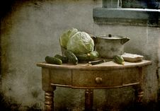 Still Life With A Cabbage And Cucumbers Stock Image