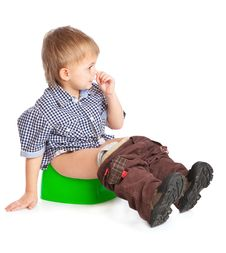 A Boy Sitting On The Pot Royalty Free Stock Images