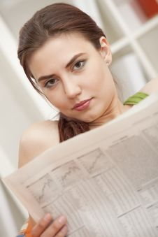 Free Woman With Newspaper At Home Royalty Free Stock Image - 19976386