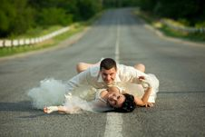 Free Bride And Groom On Countryside Road Stock Photo - 19976960