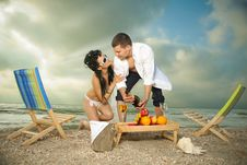 Free Couple Resting On The Beach Stock Photos - 19976963
