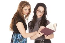 Two Women Reading Book Stock Photography