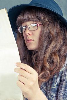 Girl In Glasses Reading Newspaper Stock Photo