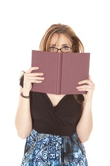 Woman Is Looking Over Book Stock Images