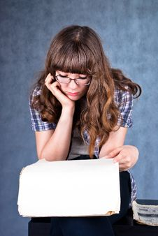 Girl In Glasses Reading Newspaper Royalty Free Stock Photo