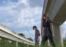 Free Asian Couple Walking Near Rail Track Royalty Free Stock Images - 19984499