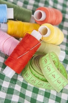 Free Coils With Colored Threads On A Checkered Tableclo Royalty Free Stock Images - 19986029