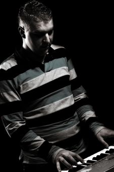 Free Boy Plays Piano Royalty Free Stock Image - 19986636