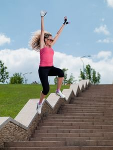 Woman In Sportswear Jumping Stock Photos