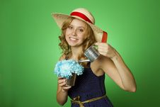 Free Attractive Girl Watering Flowers Stock Image - 19990891