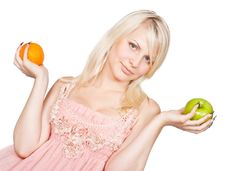Young Beautiful Blonde Girl And Apple And Orange