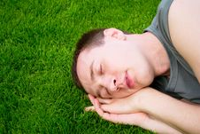 Free The Young Man Sleeps On  Green Grass Stock Photos - 19992163