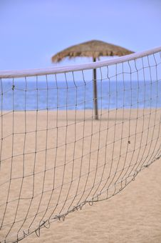 Free Sunshade And Sand Volleyball Net On Beach Stock Photography - 19998022