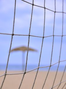 Free Sunshade Behind Sand Volleyball Net On Beach Royalty Free Stock Photo - 19998025